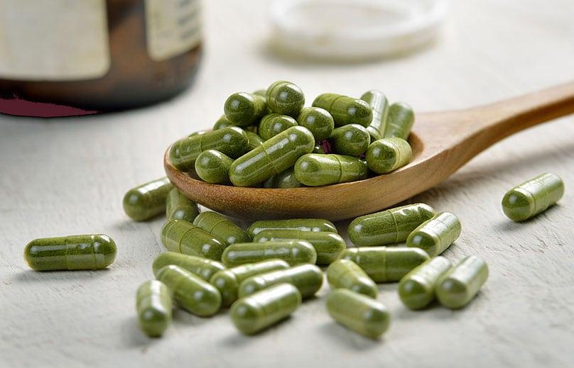 Green colored probiotic capsules